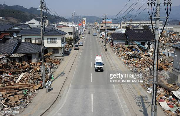 Vehicles move on the open road next to tsunami devastation in Ofunato city Iwate prefecture on April 15 2011 Japan's seismologists were so entrenched...