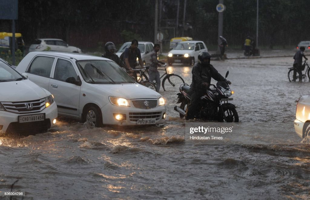 Vehicles move on waterlogged road at 47 due to rain on August 21 2017 in Chandigarh India Heavy rainfall on morning brought the tricity to a stand...
