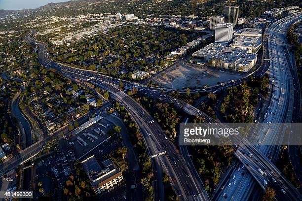 Vehicles move slowly in rush hour traffic on the Interstate 405 freeway and US 101 freeway interchange in this aerial photograph taken over Los...