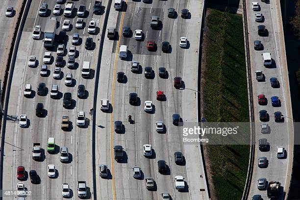 Vehicles move slowly in rush hour traffic on the Interstate 405 freeway in this aerial photograph taken over the Westwood neighborhood of Los Angeles...