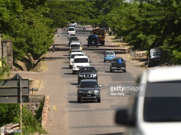 Vehicles move the bodies of Óscar Alberto Martínez Ramírez and his daughter Valeria to San Romero memorial park of la Bermeja Cemetery on June 30,...