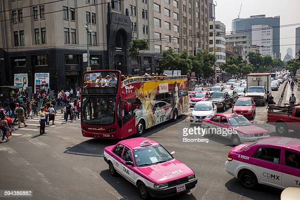Vehicles move through traffic in downtown Mexico City Mexico on Thursday Aug 11 2016 Mexico's push to reduce air pollution may set the stage for a...