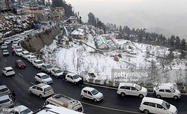 Vehicles moving slowly during the snowfall at Kufri as large number of tourists comes to enjoying the seasons first snowfall at Kufri on Christmas on...