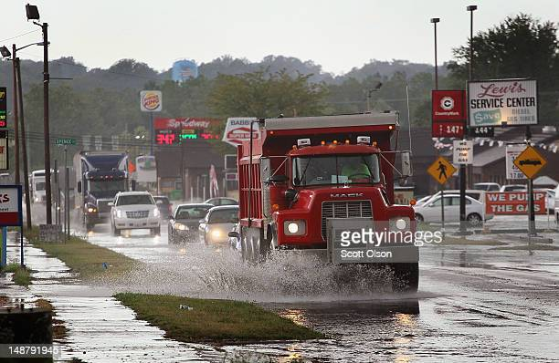 Vehicles navigate a flooded street after a sudden rain storm on July 19 2012 in Spencer Indiana The corn and soybean belt in the middle of the nation...