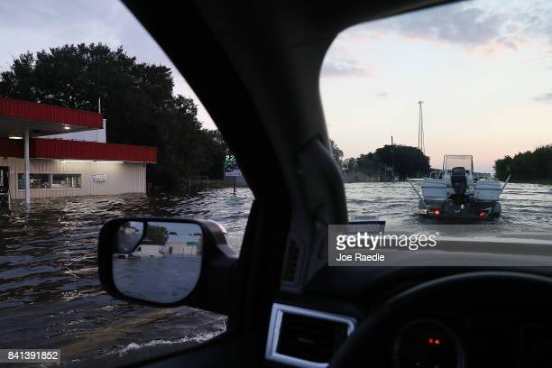Vehicles navigate hwy 90 after parts of the road were flooded by Hurricane Harvey causing an approximately four hour west bound traffic backup on...