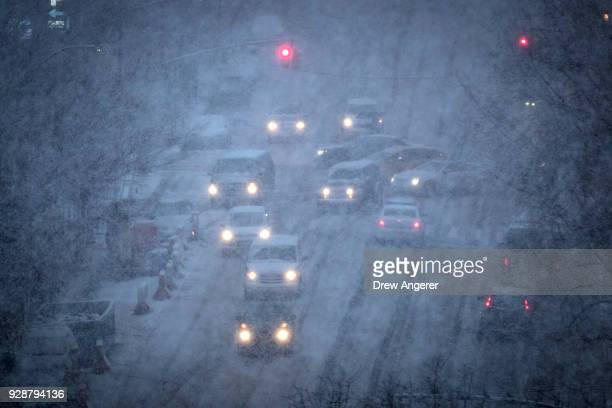 Vehicles navigate the road conditions on Atlantic Avenue in Brooklyn during a snowstorm March 7 2018 in New York City Large portions of the East...