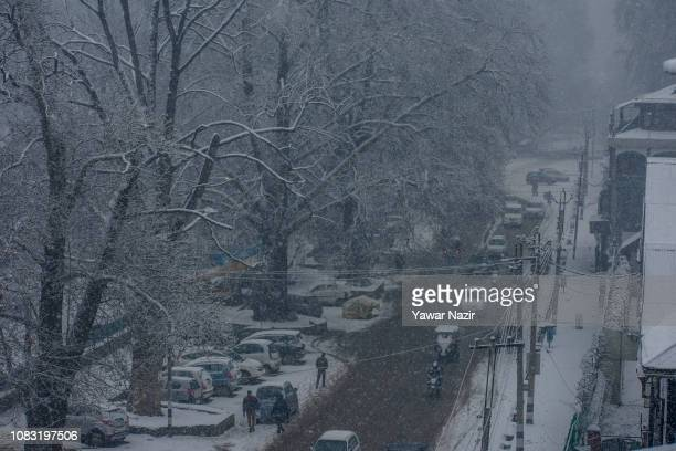 Vehicles negotiate snow flakes during a fresh snowfall on January 16 2019 in Srinagar the summer capital of Indian administered Kashmir India Kashmir...