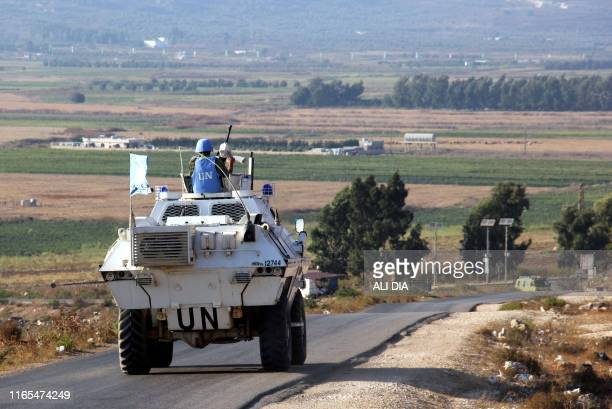 Vehicles of a convoy United Nations Interim Forces in Lebanon ride on a road along the border between Lebanon and Israel near the southern Lebanese...