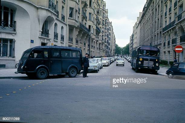 Vehicles of police parked at the exit of the street Cognac Jay.