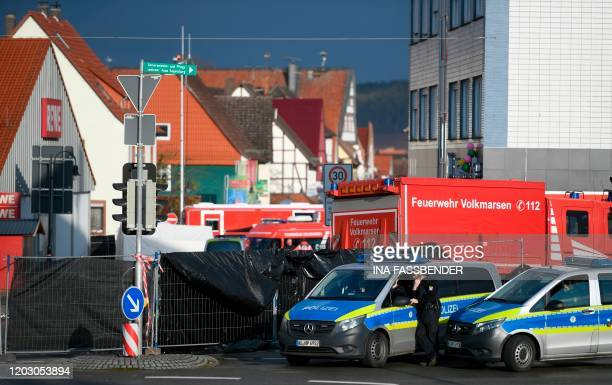 Vehicles of the police and the fire brigades stand at the site where a man who drove into a carnival procession on February 25 2020 in Volkmarsen...