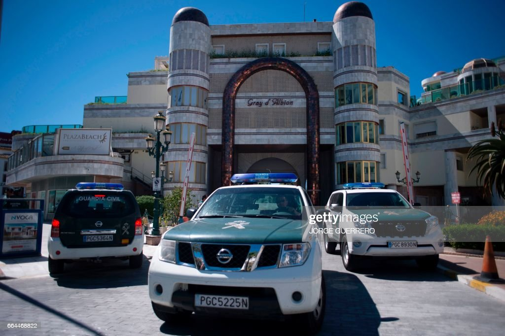 Vehicles of the Spanish Guardia civil are parked outside a