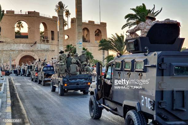 "Vehicles of the ""Tripoli Brigade"", a militia loyal to the UN-recognised Government of National Accord , parade through the Martyrs' Square at the..."