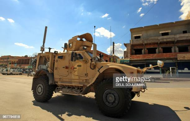 Vehicles of the USled coalition battling the Islamic State group patrol the town of Rmelane in Syria's Hasakeh province on June 5 2018 The leading...