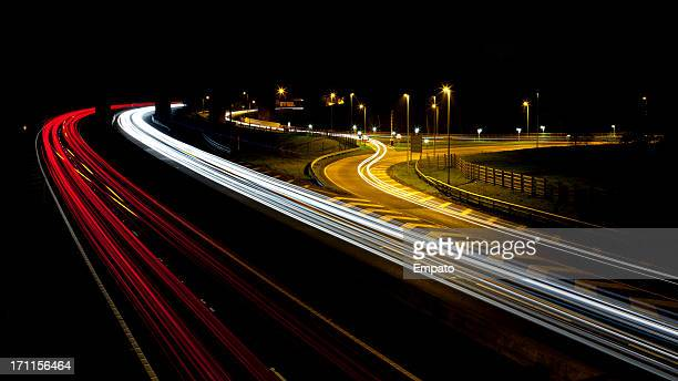 Vehicles on a motorway at night.
