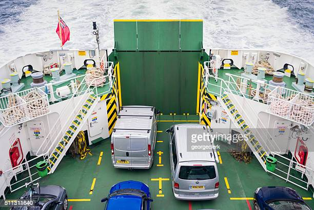 Vehicles on a small ferry