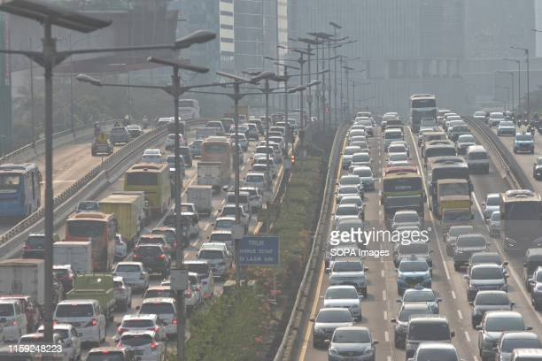 Vehicles on a Toll road with dense polluted air Jakarta has lately been at the top of the list of cities with the worst air quality in the world...
