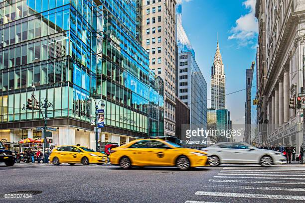 Vehicles on city street by Chrysler building