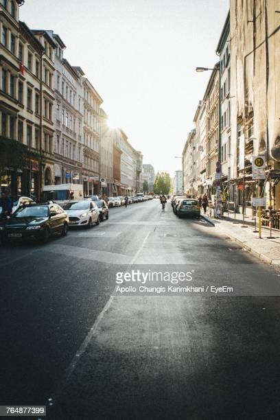 vehicles on road along buildings - kreuzberg stock photos and pictures