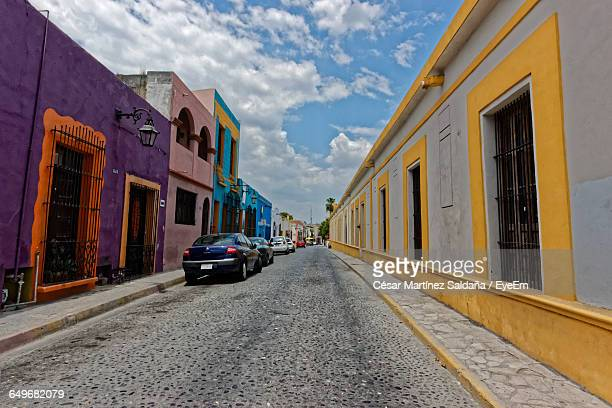 vehicles on road along built structures - monterrey stock pictures, royalty-free photos & images