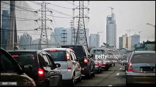 vehicles on road in city - filho stock pictures, royalty-free photos & images