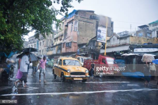 vehicles on road in monsoon, kolkata, india, asia - nissan stock pictures, royalty-free photos & images