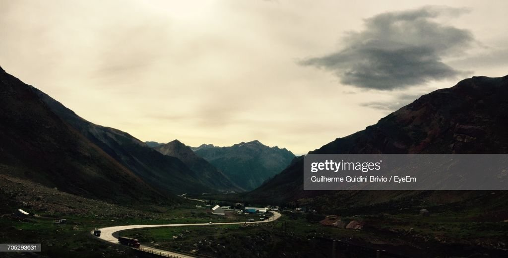 Vehicles On Road With Mountain Range In Background : Stock Photo