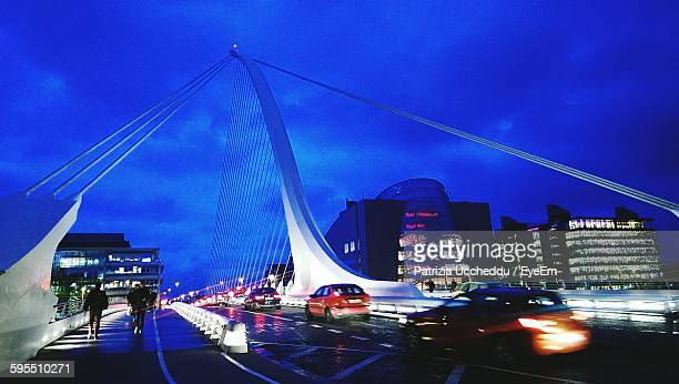Vehicles On Samuel Beckett Bridge Against Sky