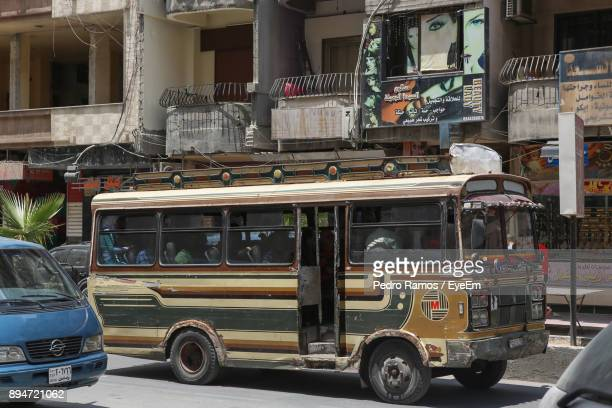 vehicles on street by building - damascus stock pictures, royalty-free photos & images