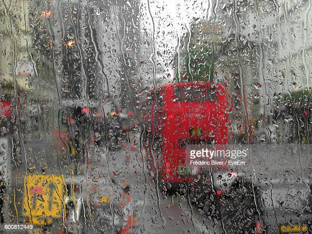 vehicles on street seen through wet window - torrential rain stock pictures, royalty-free photos & images