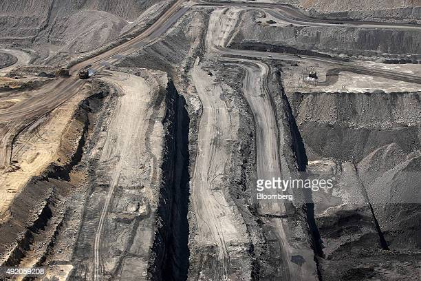 Vehicles operate in an open pit at Glencore Plc's Bulga Coal operations in this aerial photograph taken near Singleton Australia on Saturday Oct 3...