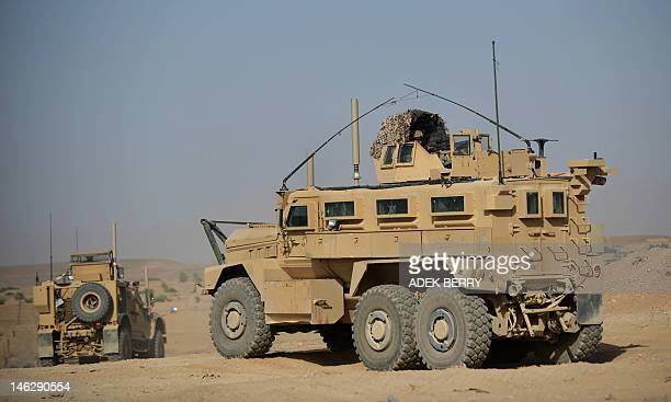 vehicles operated by US Marines from 1st Battalion 7th Marines Regiment leave PB Fulod in Sangin on June 12 2012 The USled war in Afghanistan has...