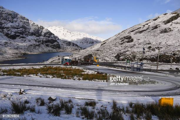 Vehicles park at the top of the A83 Rest and Be Thankful as wintery conditions return on January 31 2018 in Arrochar Scotland Motorists were warned...