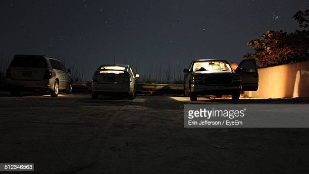 Vehicles parked against the sky at night