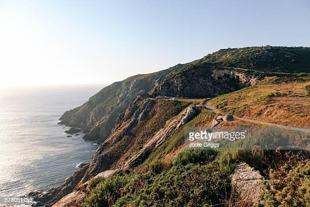 vehicles parked on rugged coastal headland - comunidad autónoma de galicia fotografías e imágenes de stock