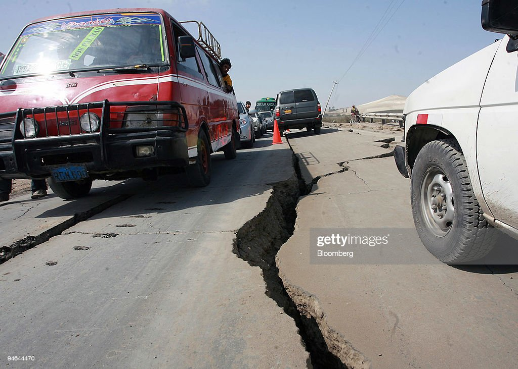Vehicles pass by a cracked portion of the Pan American highw : News Photo