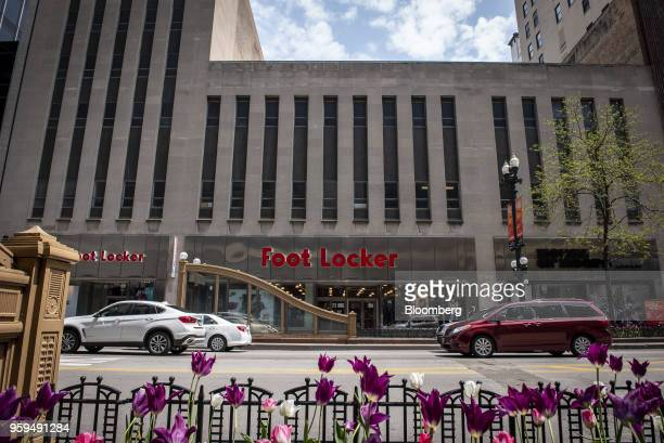 Vehicles pass in front of a Foot Locker Inc store in downtown Chicago Illinois US on Sunday May 13 2018 Foot Locker Inc is scheduled to release...