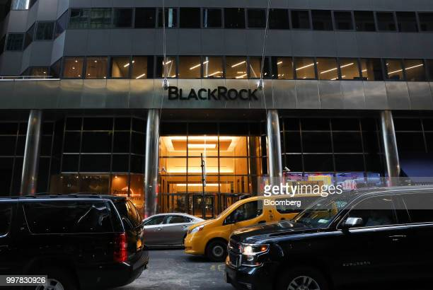 Vehicles pass in front of BlackRock Inc headquarters in New York US on Wednesday June 11 2018 BlackRock Inc is scheduled to release earnings figures...