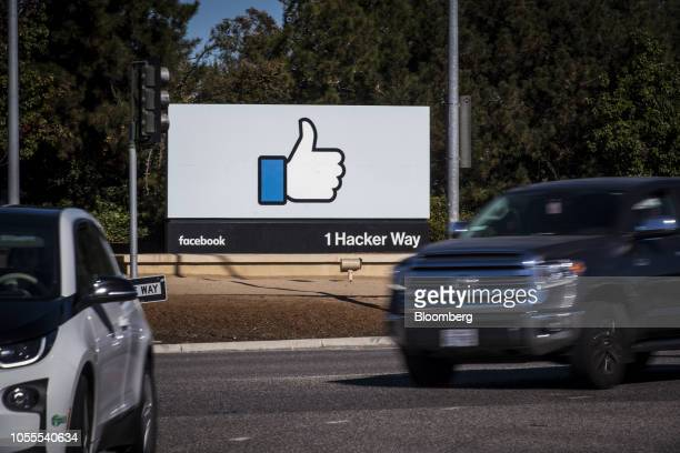 Vehicles pass in front of signage displayed outside Facebook Inc. Headquarters in Menlo Park, California, U.S., on Tuesday, Oct. 30, 2018. Facebook...