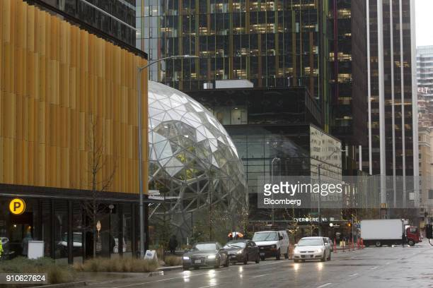 Vehicles pass in front of the Amazoncom Inc Spheres in Seattle Washington US on Tuesday Jan 23 2018 The online retailer is scheduled to unveil the...