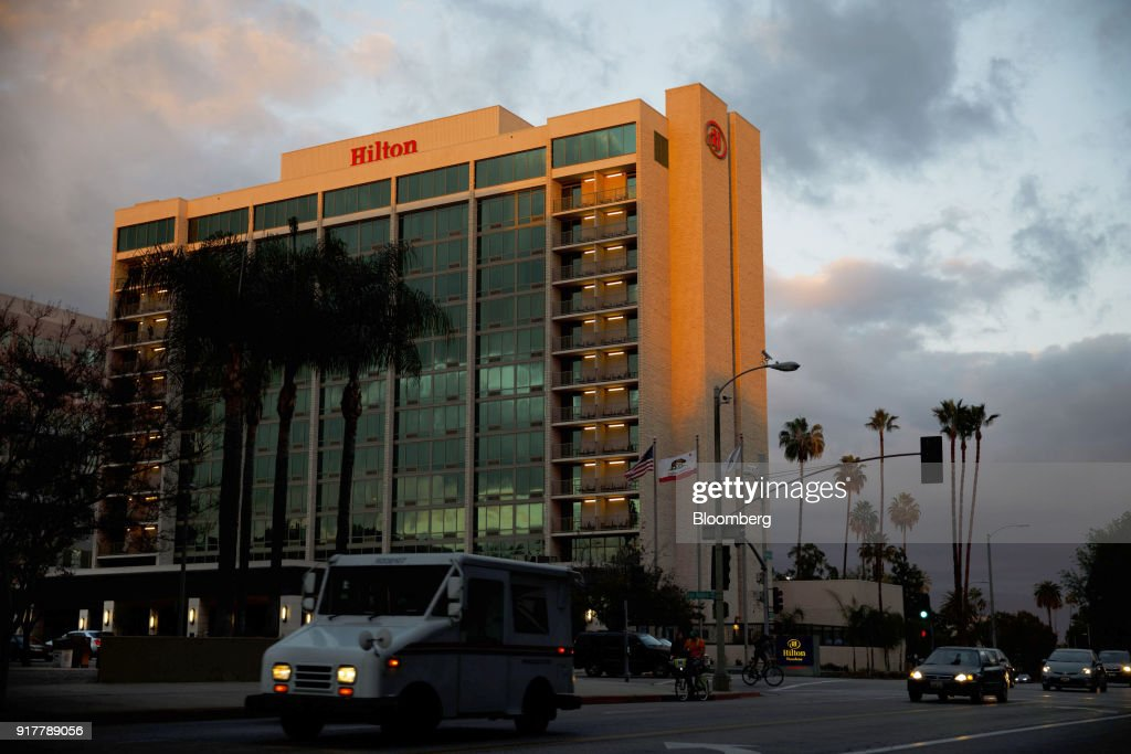 Vehicles pass in front of the Hilton Pasadena hotel in Pasadena, California, U.S., on Monday, Feb. 12, 2018. Hilton Worldwide Holdings Inc. is scheduled to release earnings on February 14. Photographer: Patrick T. Fallon/Bloomberg via Getty Images