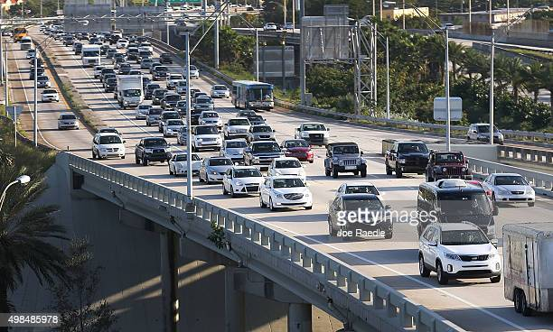 Vehicles pass on I95 as travelers prepare for the upcoming Thanksgiving Day holiday on November 23 2015 in Miami Florida AAA announced in their...