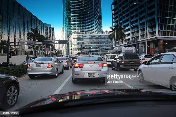Vehicles pass on the road as travelers prepare for the upcoming Thanksgiving Day holiday on November 23 2015 in Miami Florida AAA announced in their...