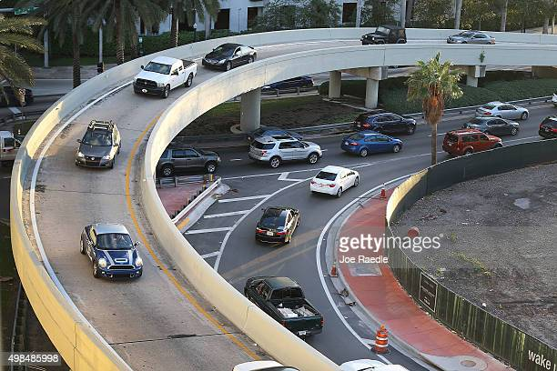 Vehicles pass on the road as travelers prepare for the upcoming Thanksgiving Day holiday on November 23 2015 in Miami Beach Florida AAA announced in...