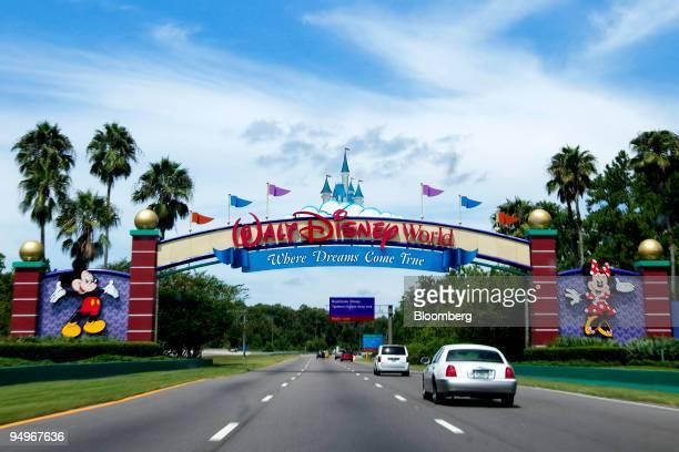 Vehicles pass the entrance to the Walt Disney World theme park and resort in Lake Buena Vista Florida US on Monday Aug 31 2009 Walt Disney Co said it...
