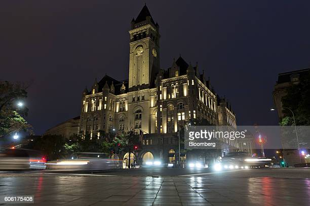 Vehicles pass the Trump International Hotel formerly the Old Post Office Pavilion in Washington DC US on Friday Sept 16 2016 The hotel opened on...