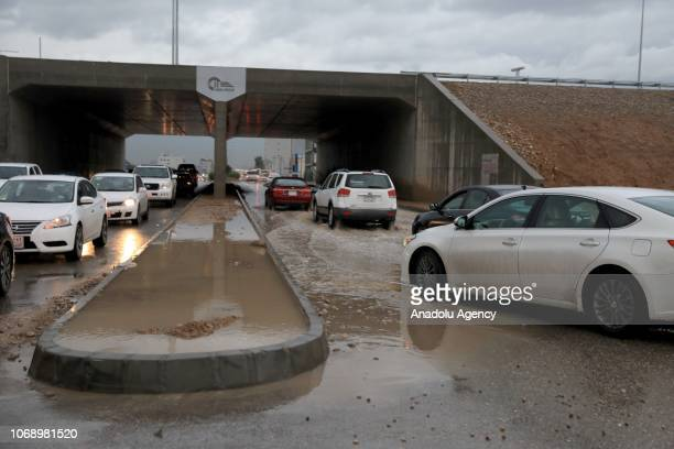 Vehicles pass through a flooded road following a heavy rainfall on December 6 2018 in Erbil Iraq