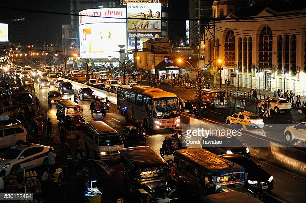Vehicles pass through a main road a day after elections on May 10 2016 in Manila Philippines Rodrigo Duterte is poised to win the presidential...