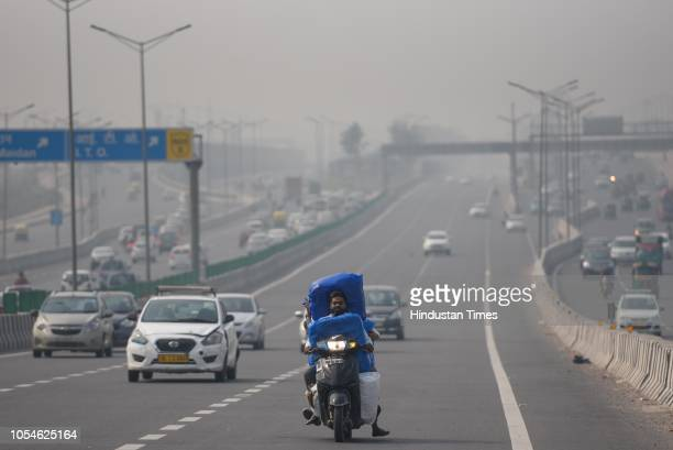 Vehicles pass through National Highway 24 amid layer of smog as the air pollution level increased on October 28 2018 in New Delhi India The Supreme...