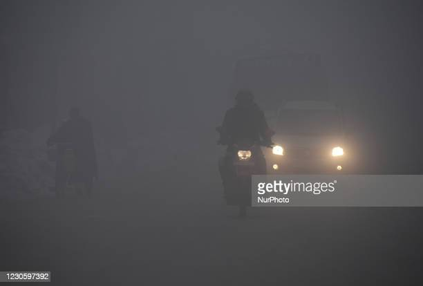 Vehicles ply amid dense fog in Srinagar, Kashmir on January 15, 2021.A meteorological department official said that Srinagar, the summer capital of...