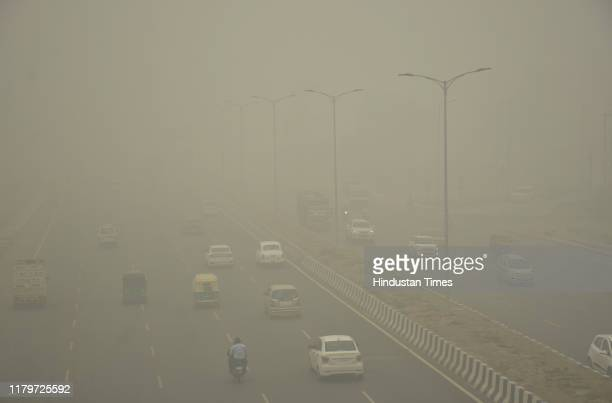 Vehicles ply on road amid heavy smog, at NH 9 road, on November 3, 2019 in Ghaziabad, India. The air quality index hit 473 at 9 am, according to...
